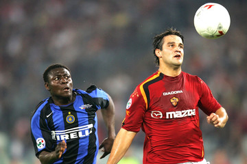 AS Roma's Chivu fights for the ball with Martins of Inter Milan at Olympic stadium in Rome.