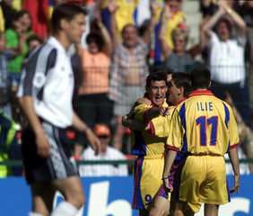 ROMANIA'S VIOREL MOLDOVAN CELEBRATES HIS GOAL WITH TEAMMATES.