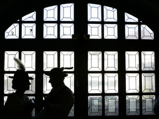 A couple in traditional Bavarian clothes is pictured silhouetted during the unofficial traditional B..