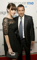 """Actors Adam Sandler and Liv Tyler smile as they arrive to attend the premiere of the film """"Reign Over Me"""" in New York"""