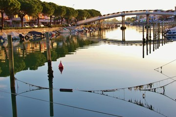 Foto op Plexiglas Stad aan het water Canal and boats in Grado in bright morning light. North-Eastern Italy, Europe.