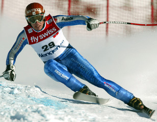 BRUNO KERNEN OF SWITZERLAND TAKES CURVE DURING DOWNHILL TRAINING RUN ONLAUBERHORN WORLD CUP ...