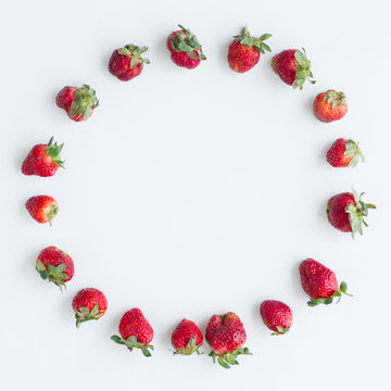 Oval frame of strawberries on white background. Flat lay, top view. Size 1x1