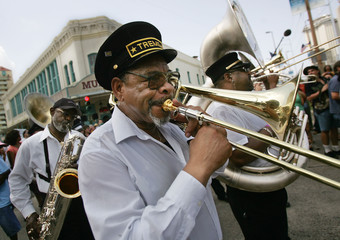 New Orleans musicians perform during a Jazz funeral march dedicated to the victims of the Hurricane Katrina in front of the convention center in New Orleans