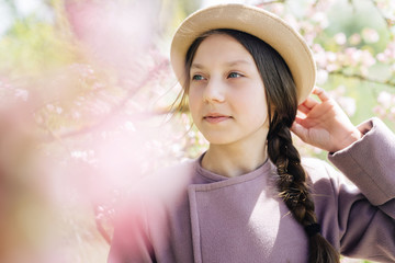 Portrait of a girl in a hat close-up of a spring