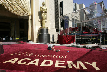 Worker prepares the red carpet outside the Kodak Theatre in Los Angeles.