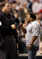 Recording artist Aaron Neville performs during seventh inning in Game 3 of 2005 World Series in Houston