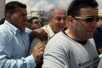 PALESTINIAN MINISTER FOR JERUSALEM AFFAIRS FAISAL HUSSEINI RUNS FROM TEAR GAS DURING NAKBA DEMO IN AL RAM.