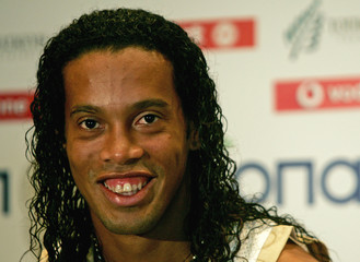 Brazilian soccer star Ronaldinho smiles during news conference in Athens.