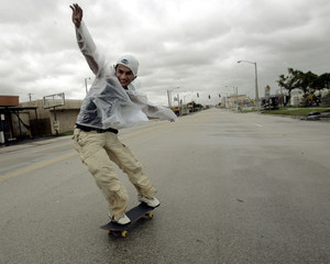 Maurice Rodriguez is propelled on skateboard by the winds from Hurricane Wilma in Miami