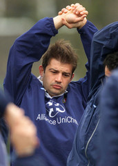 ITALY'S RUGBY CAPTAIN MOSCARDI WARMS UP DURING PRACTICE IN LONDON.