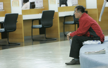 An unemployed person waits for his turn to claim an unemployment benefit at an office of the Employment Information Service in Seoul