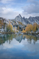 Autumn trees and mountains reflected in lake, The Enchantments, Washington, USA