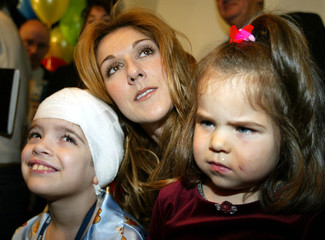 CELINE DION POSES WITH SICK CHILDREN AT MONTREAL HOSPITAL.