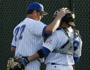 Trenton Thunder pitcher Roger Clemens chats with catcher P J Pilittere before the start of the Thunder versus the Portland Sea Dogs Eastern minor league baseball game in Trenton New Jersey