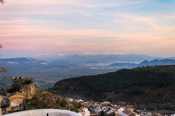 Idyllic panorama view of Sierra Nevada during sunset in March, captured in Moclín, Andalusia, Spain