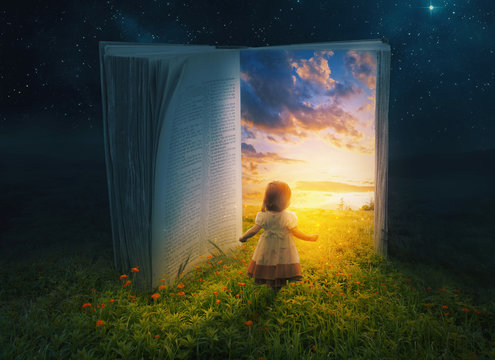 Little girl and open book