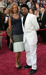 Director Spike Lee and wife Tanya Lewis arrive at the 77th annual Academy Awards.
