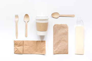 breakfast take away with paper bags on white table background top view mock up