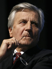 European Central Bank President Trichet looks on before a conference in Lausanne