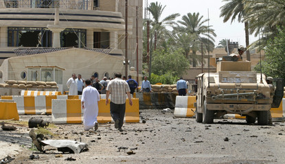 US soldiers stand watch at scene of suicide car bombing in Baghdad.