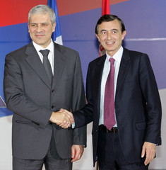 Serbian President Tadic shakes hands with French FM Douste-Blazy after their meeting in Belgrade