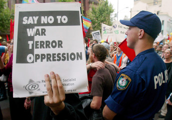 PROTESTER HOLDS BANNER DURING MARCH AGAINST WTO MEETING IN SYDNEY.