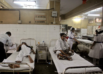 Victims of train blasts are treated at hospital in Mumbai