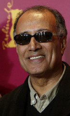 Iranian director Kiarostami poses during a photocall for the film 'Tickets' in Berlin.