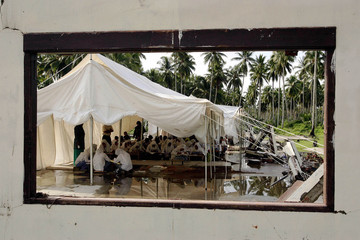 Acehnese high school students take their lessons in a tent, Teunom.
