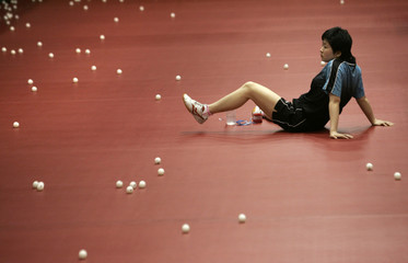 Member of China's national table tennis team rests at Beijing's National Gymnastics Centre