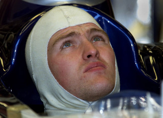 WILLIAMS DRIVER RALF SCHUMACHER SITS IN HIS CAR DURING PRACTICE.