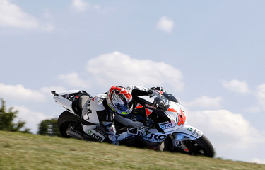 Honda MotoGP rider Talmacsi of Hungary takes a curve during the classification for the Czech Grand Prix at the Masaryk Circuit in Brno