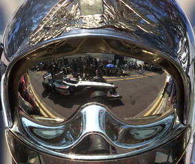 MCLAREN MERCEDES' DAVID COULTHARD IS REFLECTED IN THE HELMET OF A FIREMAN DURING QUALIFYING FOR THE ...