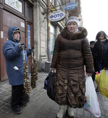 A woman sells dried mushrooms on a street in central St. Petersburg
