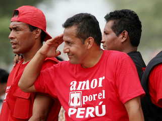 Peruvian presidential candidate Humala salutes during campaing rally in Piura