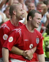 ENGLAND'S ROONEY CELEBRATES WITH BECKHAM AFTER SCORING IN THEIR EURO 2004 MATCH IN LISBON.
