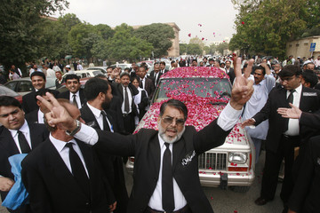 Lawyers chant slogans as they receive deposed Chief Justice of Sindh provincial High Court Justice Sabihuddin Ahmed in Karachi