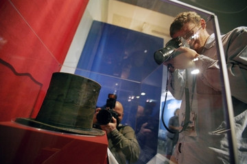 Photographers take pictures of U.S. President Abraham Lincoln's hat at the Smithsonian museum in Washington