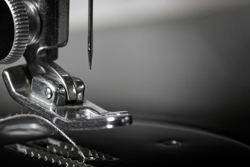 Get Needled: Macro photograph, part of a 1940's sewing machine. Sharp, detailed photo of the needle and pusher. Background layer in multiple business and industrial applications or as wall hanging.
