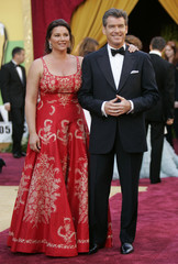Actor Pierce Brosnan arrives with his wife Keely Shaye Smith at the 77th annual Academy Awards in Hollywood.