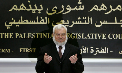 Palestinian parliament Speaker Dweik prays during first session of Legislative Council in Ramallah
