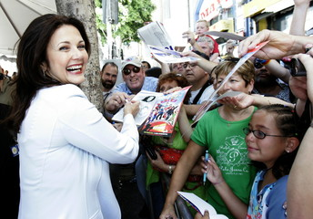 Lynda Carter signs autographs at the worldwide premiere of Sky High.