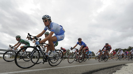 "The pack of riders cycle during the 12th stage of the Tour of Spain ""La Vuelta"" cycling race between Burgos and Suances"