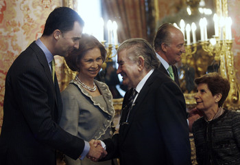Spanish Crown Prince Felipe smiles at Spanish poet Gamoneda during a reception at the Royal Palace in Madrid