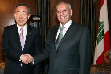 U.N. Secretary-General Ban Ki-moon shakes hands with parliament speaker Nabih Berri after a meeting in Beirut