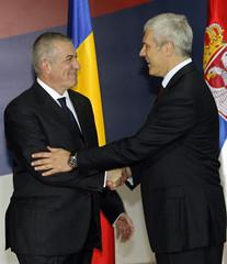 Serbian President Tadic greets Romanian Prime Minister Tariceanu in Belgrade