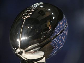 New England Patriots head coach Bill Belichick is reflected in the Vince Lombardi Trophy in Phoenix
