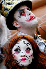 Artists dressed as Scary Doll (bottom) and Circus Freak pose at Hong Kong's Ocean Park in Hong Kong ..