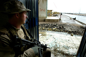 A US SOLDIER PATROLS THE ENTRANCE OF THE PORT IN THE SOUTHERN IRAQITOWN OF UMM QASR.